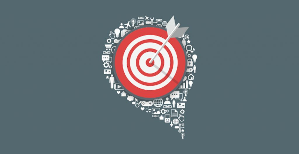 A visual of a bullseye target with an arrow in it